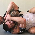 Chris takes his student through the basics of a rear naked choke