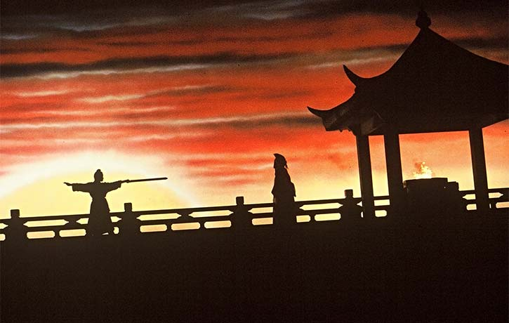 Jianshu performed against an orange sunset