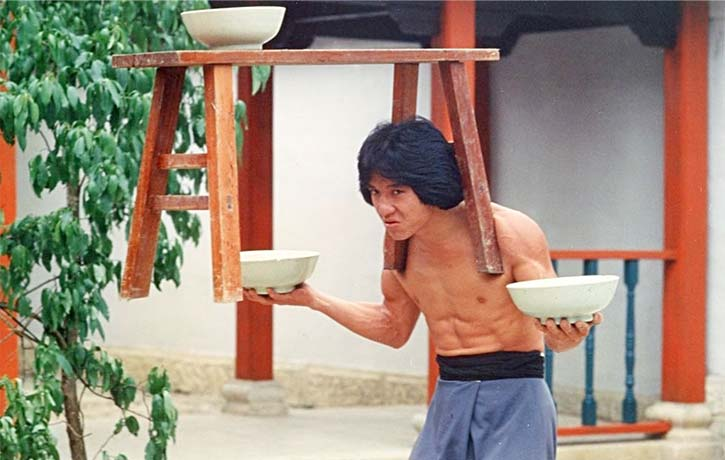 Our first glimpses of Jackie Chan are simple pieces of physical comedy