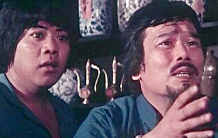 Chiang Kam as the waiter befriends Little Mute