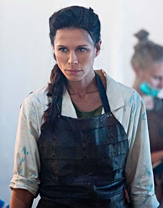 Rhona Mitra as Dr. Mal treats aliens in hospital