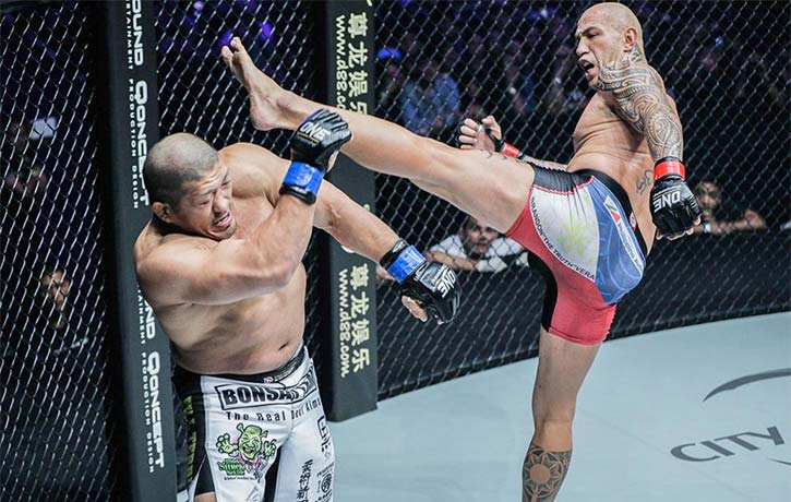 Brandon Vera lands a high kick on Hideki Sekine