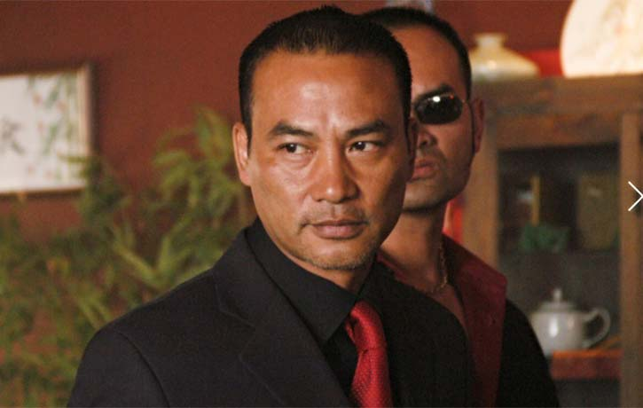 Simon Yam is also absolutely chilling as a ruthless Triad boss