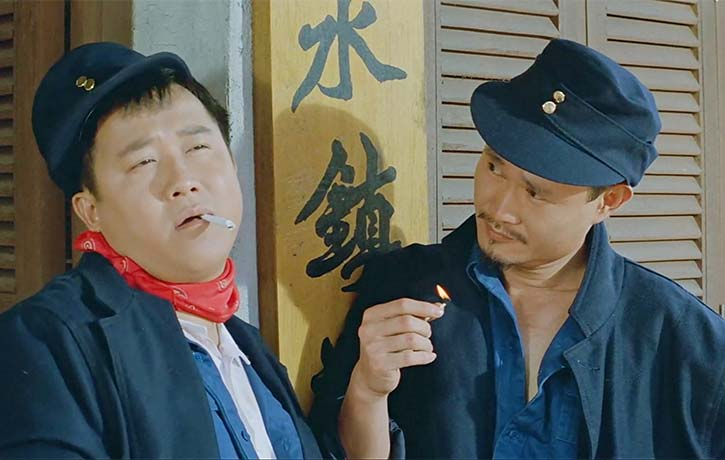 Eric Tsang and Lam Ching Ying contemplate something shady