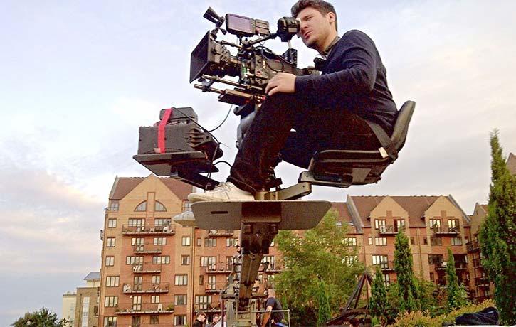 James oversees a crane shot on set